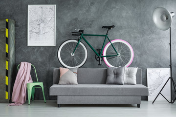 Dark grey studio with bicycle