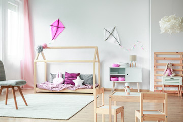Pink kite in child's bedroom