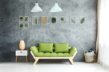 Pastel lamps above green sofa