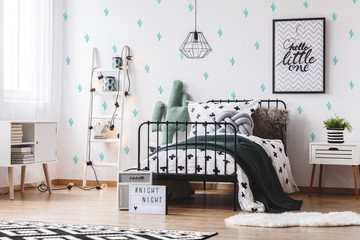 Bedroom with cute cactus wallpaper