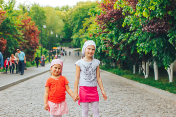 two orthodox girls in kerchiefs go to church