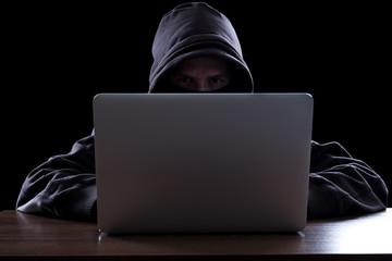 Fototapeta Anonymous hacker in the dark