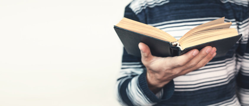 Man holding bible.