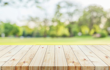 Wood table on blur green bokeh background used for display product