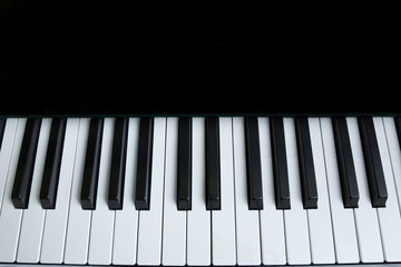 Piano keyboard. Top view, flat lay. Background with copy space