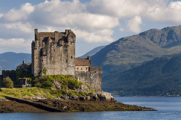 View of the Eilean Donan Castle in the Highlands of Scotland, United Kingdom; Concept for travel in Scotland