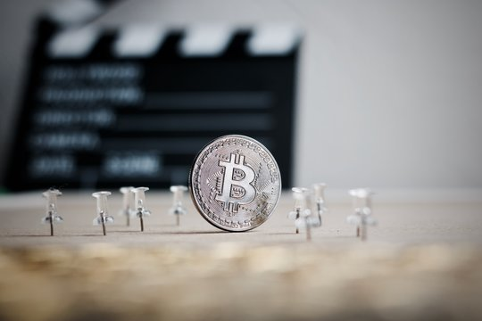 Bitcoin coin in the cinema