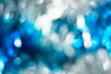 Abstract background with white and blue bokeh