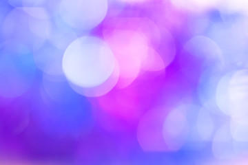 Multicolored bokeh. Blue and pink lights are blurred.