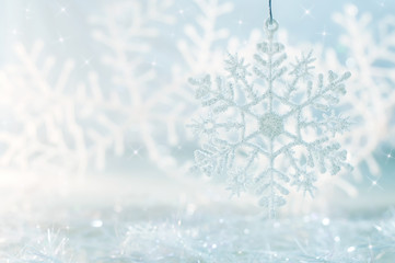Snowflake on a blue festive background. Beautiful Christmas background