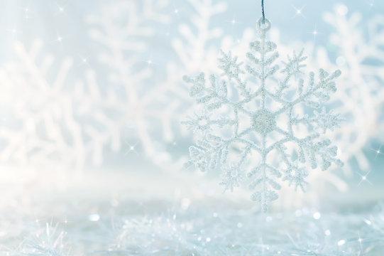 Snowflake on a blue festive background. Beautiful Christmas background