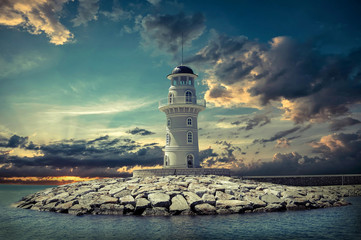 Lighthouse on the sea under sky
