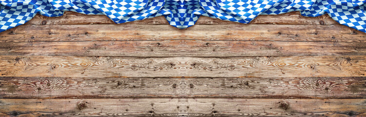 Rustic background for Oktoberfest with bavarian white and blue fabric on wooden Wall mural
