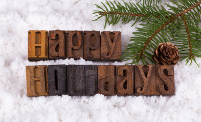 Happy Holidays Text on a Background of Snow