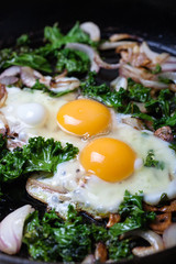 Fried eggs with vegetables.