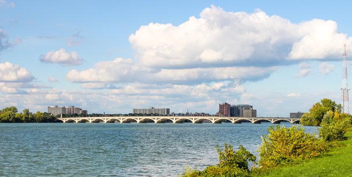 Detroit, MI, USA - 2 October 2016: MacArthur Bridge viewed from Belle Isle. The MacArthur Bridge spans the Detroit River between Detroit, Michigan and Belle Isle.