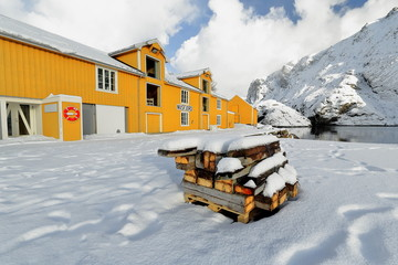 Old wooden port warehouse painted yellow-white casement windows. Nusfjord-Flakstadoya-Lofoten-Norway. 0505
