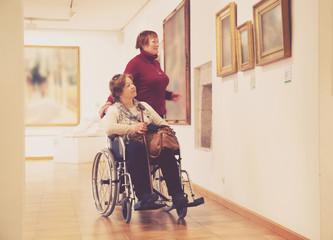 Two woman in art gallery
