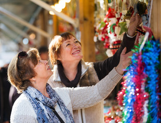 Female pensioners buying X-mas decorations