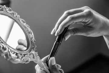 looking at mirror for make up