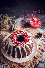 Marble cake with chocolate and pomegranates,selective focus