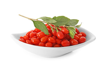 Plate with goji berries on white background