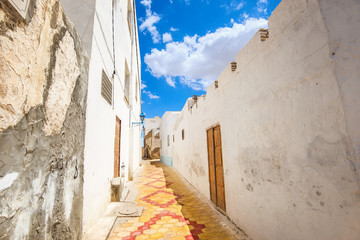 Typical alley with old houses in Medina of Kairouan. Tunisia, North Africa