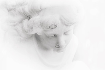 fragment of antique statue of an white angel as a symbol of love, faith and hope (Christianity, religion, goodness,  immortality concept)