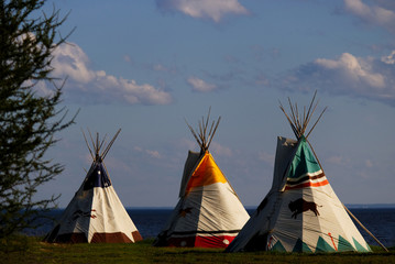 Bunch of teepee forgotten on an empty lot by the ocean in Maria, Quebec