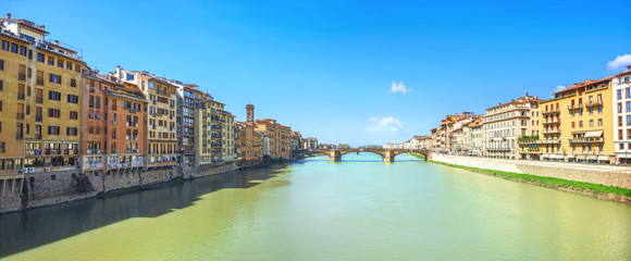 Cityscape with River Arno in Florence in sunny day. Tuscany, Italy