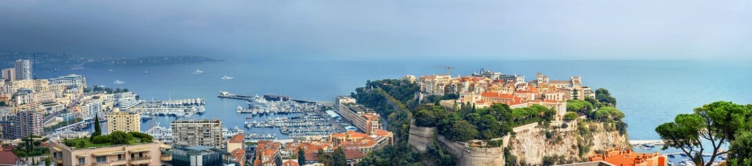 Panoramic view of Monaco coast at sunset in overcast day