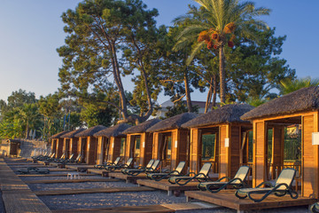 Personal lodges on the beach for sunbathe. Kemer, Turkey