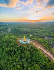 Golden big Buddha beside hight way
