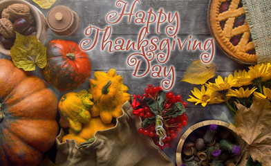 Thanksgiving day concept - traditional holiday food with pumpkins on old wooden.