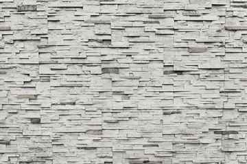 Old grey granite stone wall background texture