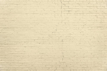 Old beige brick wall background texture