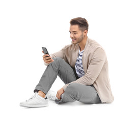 Young handsome man with mobile phone against white background