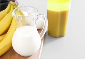 Glass pitcher of milk on table