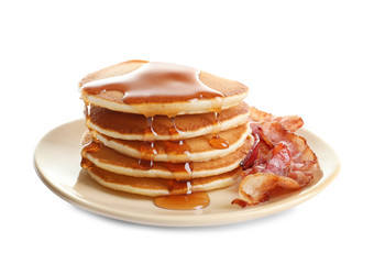 Plate with pancakes and bacon on white background