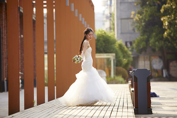 outdoor portrait of asian bride