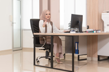 Muslim Businesswoman Showing Ok Sign With His Thumb-up