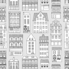 Seamless pattern with little hand drawn houses, black and white