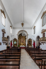 Interior of the Saint Bartholomew Church, originated in the 10th century, rebuilt in the 18th century, features a 16th century Mannerist altarpiece. Coimbra, Portugal.