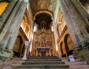 Interior of the Old Cathedral of Coimbra, a.k.a. Se Velha, a Romanesque Roman Catholic building, started in 12th century. Coimbra, Portugal.
