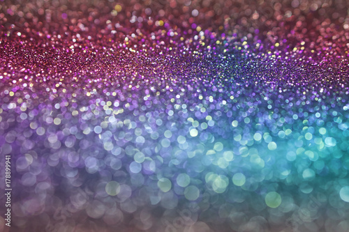 abstract colorful pink purple and blue bokeh texture background with glitter light for christmas and