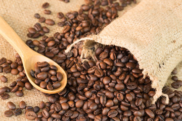 Coffee beans whit wooden spoon on wood