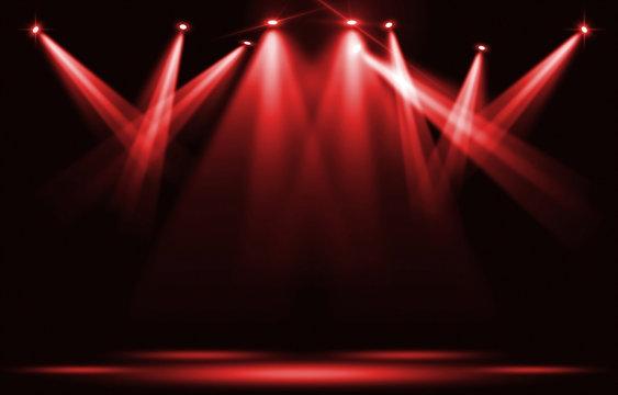 Stage lights. Red spotlight strike through the darkness.