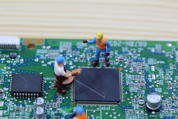 Selective focus of miniature engineer and worker fixed chip of  mainboard computer and use for business background.