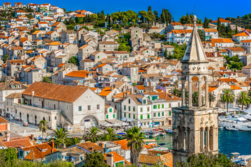 Hvar town medieval scenery. / Aerial cityscape view of medieval town Hvar, famous luxury travel place on Adriatic Coast in Dalmatia region, Croatia.