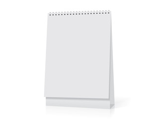 A paper white calendar stands on the table.